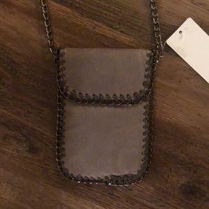 Handbags - NWT VEGAN cell phone cross body purse.